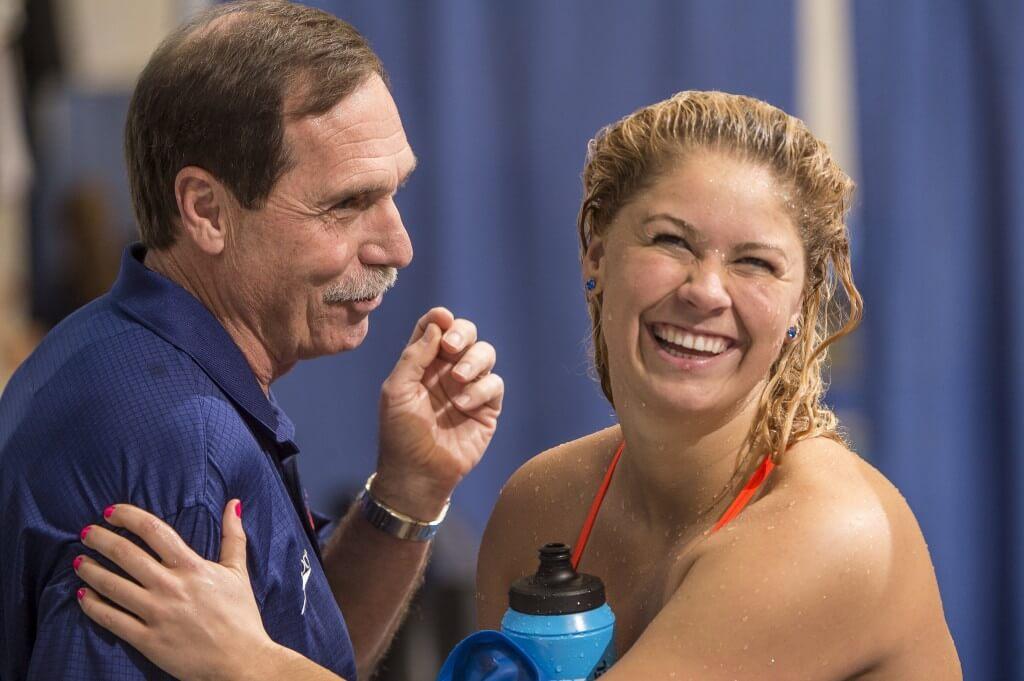 Coach Troy and Elizabeth Beisel enjoy talk before the first day preklims.