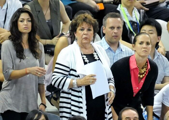 Nicole Johnson and Debbie Phelps cheer for Michael Phelps in 2011
