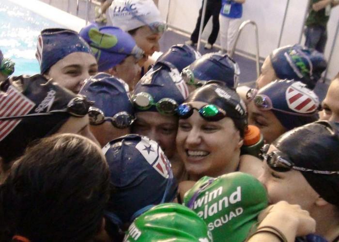 NCSA women team hug