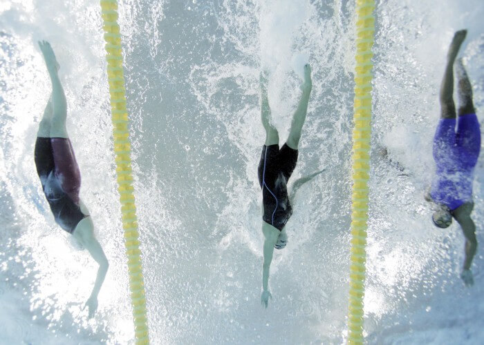 Jul 14, 2015; Toronto, Ontario, CAN; Chantal Van Landeghem of Canada (left) finishes ahead of Natalie Coughlin of the United States (middle) and Arianna Vanderpool-Wallace of the Bahamas (right) in the women's 100m freestyle swimming final during the 2015 Pan Am Games at Pan Am Aquatics UTS Centre and Field House. Mandatory Credit: Erich Schlegel-USA TODAY Sports