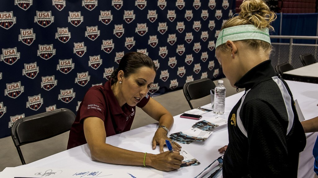 Janet Evans signing autographs in the Fan Zone.