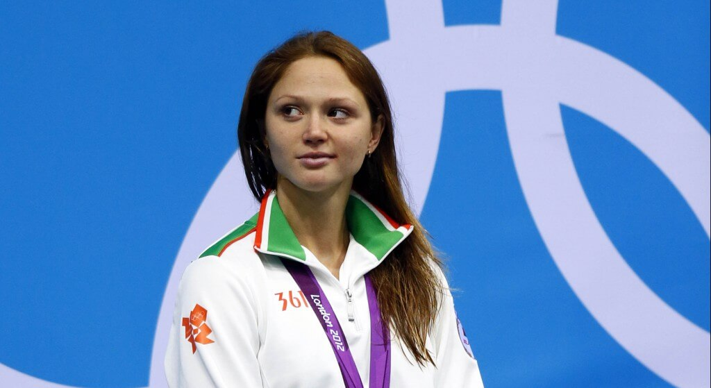 Aug 2, 2012; London, United Kingdom; Aliaksandra Herasimenia (BLR) on the podium with her silver medal after finishing second in the women's 100m freestyle final during the London 2012 Olympic Games at Aquatics Centre. Mandatory Credit: Rob Schumacher-USA TODAY Sports