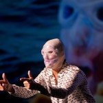 """Endurance swimmer Diana Nyad wears a jellyfish mask Thursday, Feb. 19, 2015, as she performs her one-woman play that portrays her 111-mile swim from Cuba to Key West in a Key West, Fla., theater near the beach where she concluded the record-setting athletic feat in September 2013. """"Onward! The Diana Nyad Story,"""" written and performed live by Nyad, opened Thursday night at The Studios of Key West and continues there through Sunday, Feb. 22. FOR EDITORIAL USE ONLY (Rob O'Neal/Florida Keys News Bureau/HO)"""
