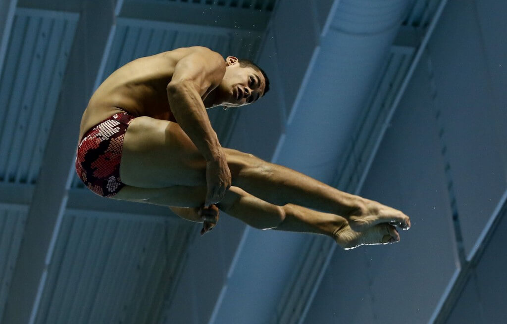 Jul 11, 2015; Toronto, Ontario, CAN; Rafael Quintero of Puerto Rico competes in the men's 3m springboard final during the 2015 Pan Am Games at Pan Am Aquatics UTS Centre and Field House. Mandatory Credit: Rob Schumacher-USA TODAY Sports