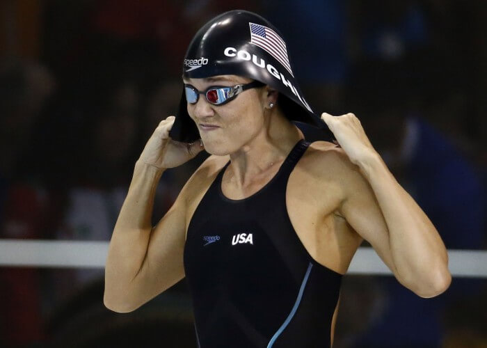 Jul 17, 2015; Toronto, Ontario, CAN; Natalie Coughlin of the United States adjusts her swim cap before the women's 50m freestyle final the 2015 Pan Am Games at Pan Am Aquatics UTS Centre and Field House. Mandatory Credit: Rob Schumacher-USA TODAY Sports
