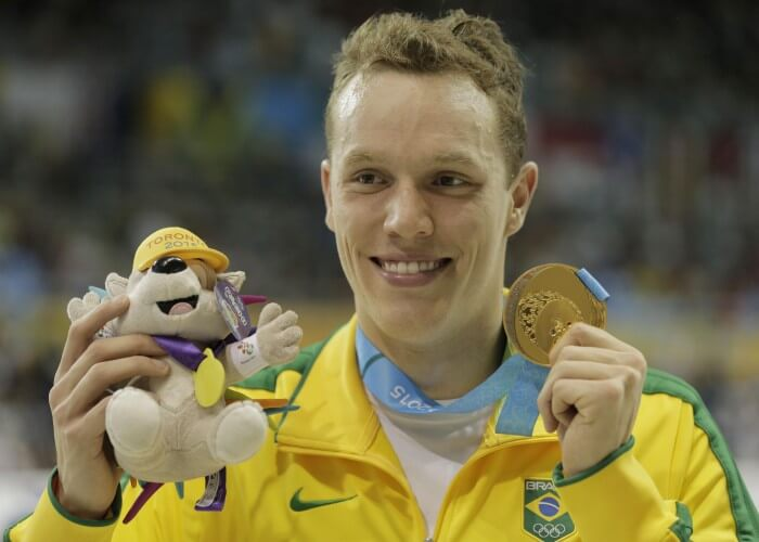 Jul 18, 2015; Toronto, Ontario, CAN; Henrique Rodrigues of Brazil poses with his gold medal after winning the men's swimming 200m individual medley final during the 2015 Pan Am Games at Pan Am Aquatics UTS Centre and Field House. Mandatory Credit: Erich Schlegel-USA TODAY Sports