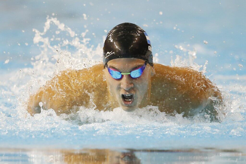 Jul 16, 2015; Toronto, Ontario, CAN; Santiago Grassi of Argentina competes in the men's swimming 100m butterfly preliminary heats during the 2015 Pan Am Games at Pan Am Aquatics UTS Centre and Field House. Mandatory Credit: Erich Schlegel-USA TODAY Sports