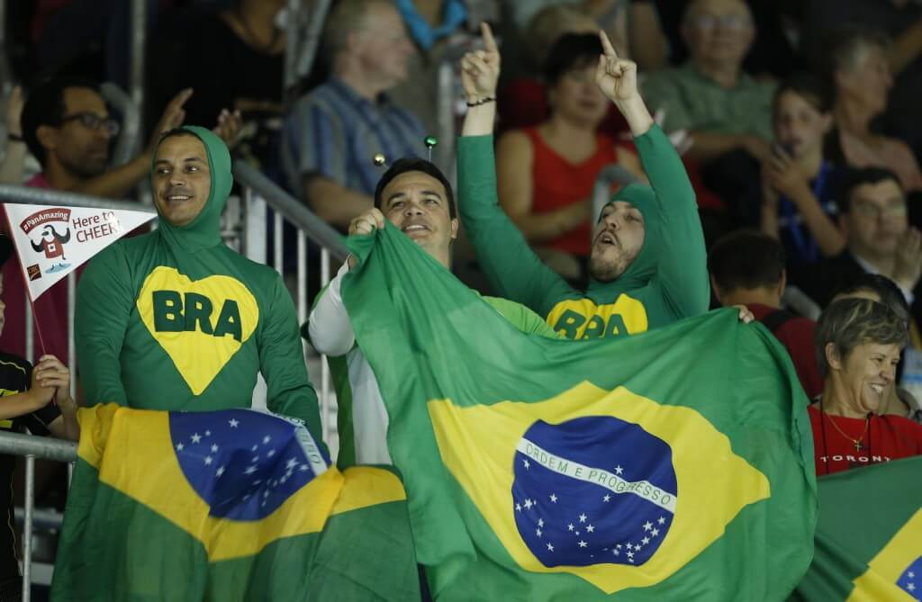 Jul 17, 2015; Toronto, Ontario, CAN; Fans of Brazil cheer during the medal ceremony for the 100m breaststroke final the 2015 Pan Am Games at Pan Am Aquatics UTS Centre and Field House. Mandatory Credit: Erich Schlegel-USA TODAY Sports
