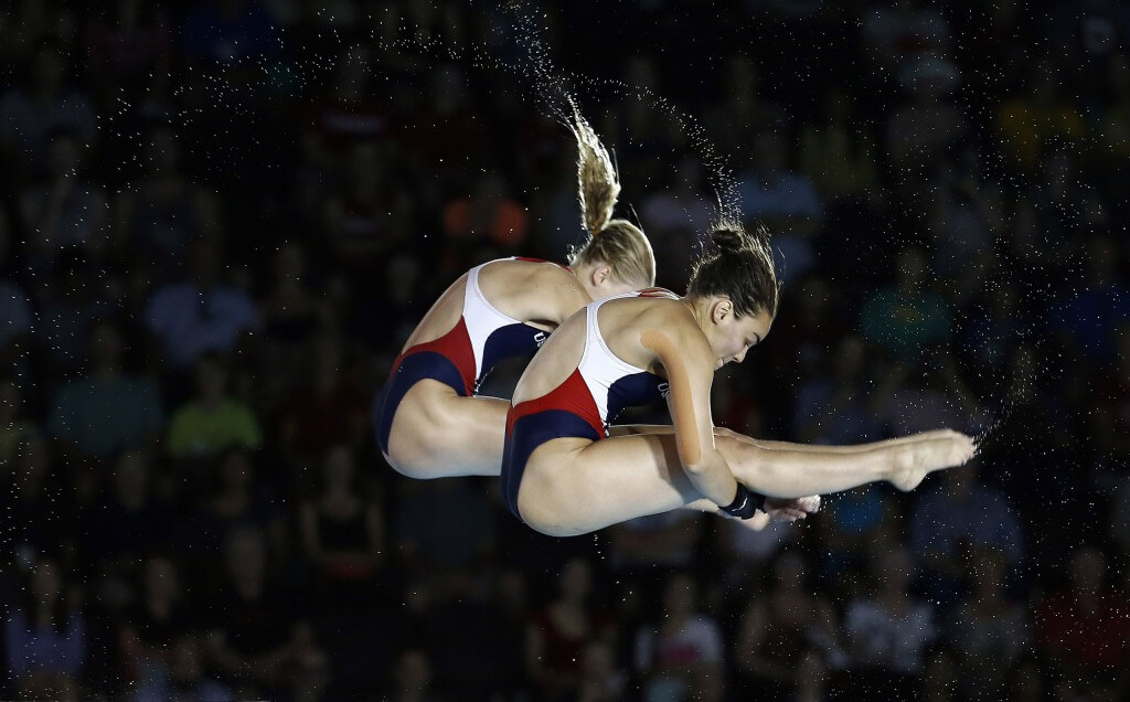 Jul 13, 2015; Toronto, Ontario, USA; Samantha Bromberg and Delaney Schnell of the United States compete in the women's synchronized 10m platform final during the 2015 Pan Am Games at Pan Am Aquatics UTS Centre and Field House. Mandatory Credit: Rob Schumacher-USA TODAY Sports