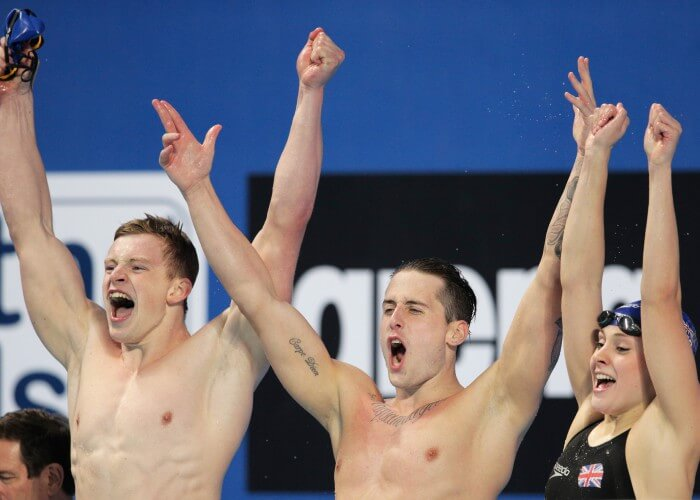 KAZAN, RUSSIA - AUGUST 05: (L-R) Adam Peaty, Chris Walker-Hebborn and Siobhan-Marie O'Connor of Great Britain celebrate winning the gold medal in a new world record of 3:41.71 in the Mixed 4x100m Medley Relay Final on day twelve of the 16th FINA World Championships at the Kazan Arena on August 5, 2015 in Kazan, Russia. (Photo by Adam Pretty/Getty Images)