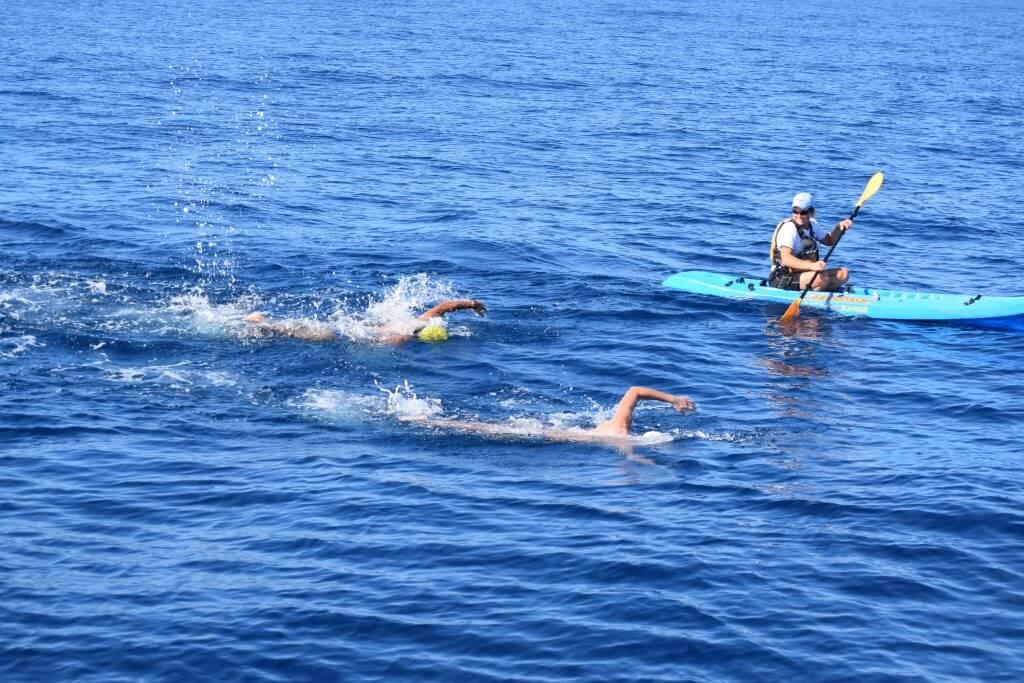 SBChan_TwoSwimmersAndAKayak
