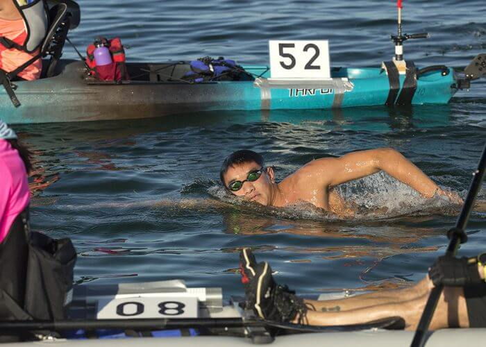 Noah Zhang, 17, strokes his way to victory in the open-water Swim for Alligator Lighthouse Saturday, Sept. 17, 2016, off Islamorada, Fla. Zhang completed the 9-mile-long ocean swim in 3 hours and 46 minutes. The competition attracted 181 contestants and was staged to create awareness of a need to preserve Alligator Lighthouse and five more historic lighthouses off the Florida Keys. Each lighthouse is more than 130 years old and no longer maintained because of modern advances in maritime navigation. (Bob Care/Florida Keys News Bureau via AP)