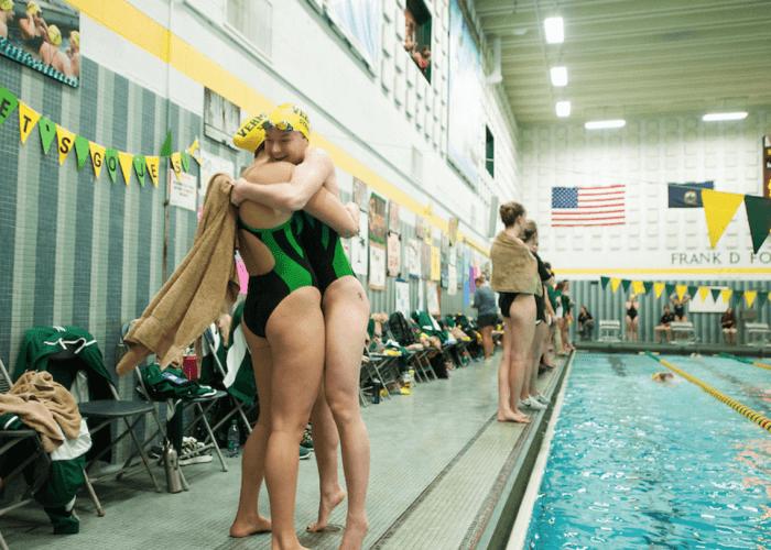 uvm-vermont-hug-teammate-love-support
