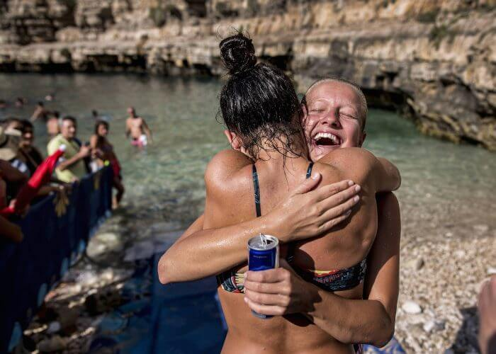 Rhiannan Iffland (R) of Australia and Jacqueline Valente of Brazil congratulate one another during the third stop of the Red Bull Cliff Diving World Series at Polignano a Mare, Italy on 23 July 2017. // Dean Treml/Red Bull Content Pool // P-20170723-01483 // Usage for editorial use only // Please go to www.redbullcontentpool.com for further information. //
