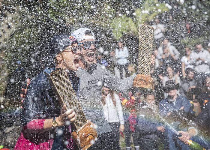 Jonathan Paredes (R) of Mexico and Rhiannan Iffland of Australia celebrate with their overall series trophy for 2017 after the sixth and final stop of the Red Bull Cliff Diving World Series at Rininahue waterfall, Lago Ranco, Chile on October 21, 2017. // Romina Amato/Red Bull Content Pool // P-20171022-00210 // Usage for editorial use only // Please go to www.redbullcontentpool.com for further information. //