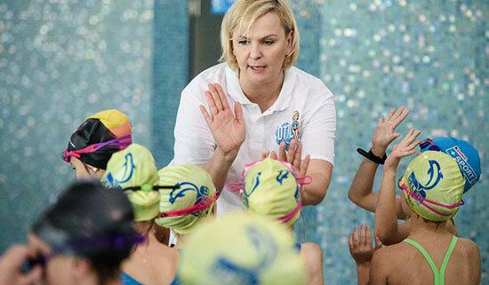 Otylia Jedrzejczak works with young swimmers