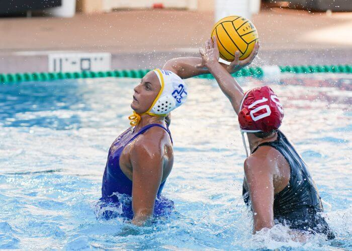 May 11, 2019; Avery Aquatic Center, Palo Alto, CA, USA; Collegiate Women's Water Polo: NCAA Semi Finals: UCLA Bruins vs Stanford Cardinals; UCLA Attacker Bronte Halligan shoots under pressure from Stanford 2MD/Driver Kat Klass Photo credit: Catharyn Hayne