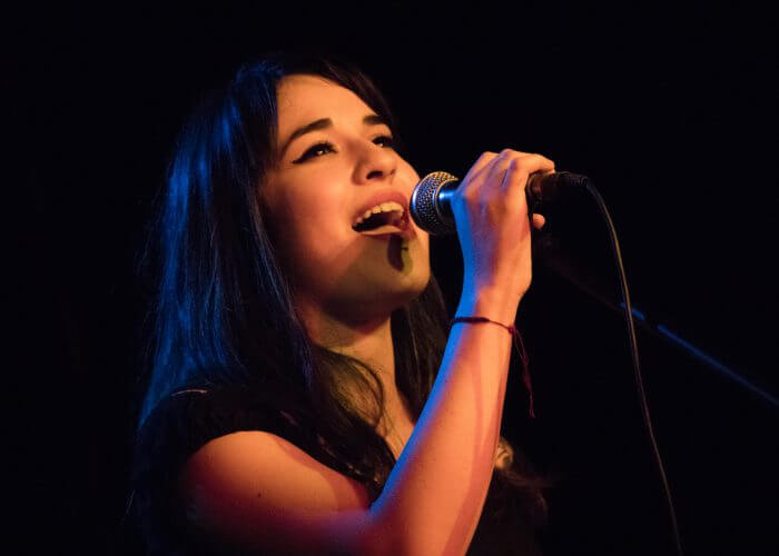 woman-breathing-in-singing