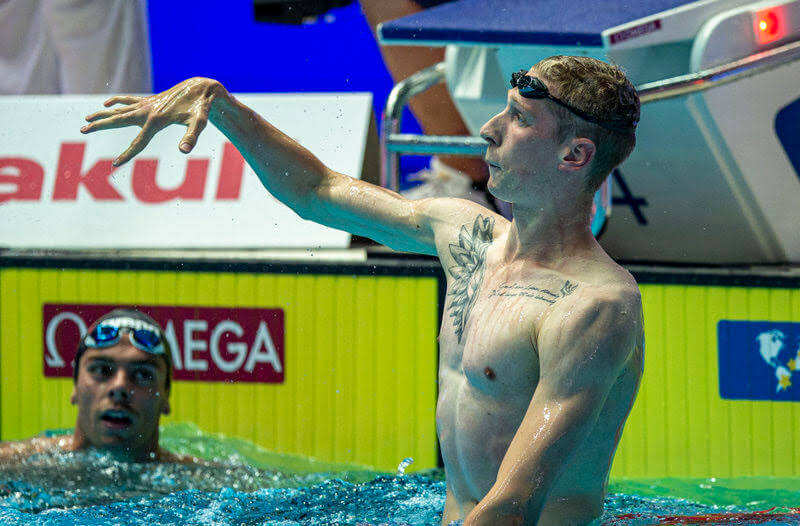 Florian Wellbrock (R) of Germany celebrates after winning in the men's 1500m Freestyle Final while third placed Gregorio Paltrinieri of Italy looks on during the Swimming events at the Gwangju 2019 FINA World Championships, Gwangju, South Korea, 28 July 2019.