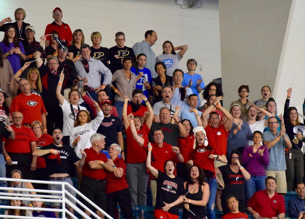 Swimming World February 2020 - GoldMinds - Partnering With Swim Parents - A Coachs Guide To Swim Parents - By Wayne Goldsmith - Photo of Georgia Parents Cheering By Annie Grevers