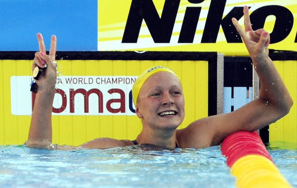 Sarah Sjostrom of Sweden celebrates after setting a new world record in the women's 100m butterfly final at the World Championships in Rome July 27, 2009. REUTERS/Alessandro Bianchi (ITALY SPORT SWIMMING IMAGES OF THE DAY)