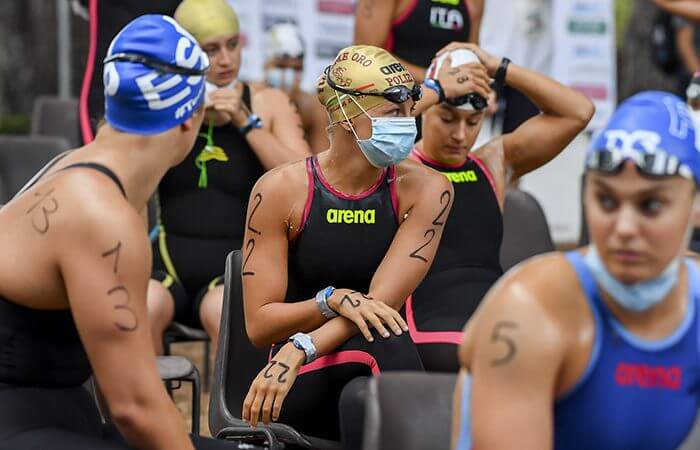 Open water swimmers with masks