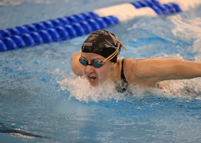 GREENSBORO, NC - MARCH 19: Swimmers competes in the Women's 100 Yard Butterfly on day three of the Division I Women's Swimming & Diving Championships held at the Greensboro Aquatic Center on March 19, 2021 in Greensboro, North Carolina. (Photo by Carlos Morales/NCAA Photos via Getty Images)