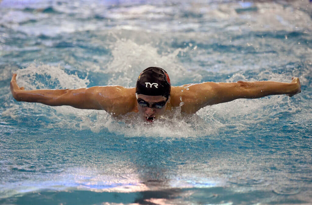 GREENSBORO, NC - MARCH 27: Nicolas Albiero of the University of Louisville Cardinals swims to victory in the 200 Yard Butterfly during the Division I Men's Swimming & Diving Championships held at the Greensboro Aquatic Center on March 27, 2021 in Greensboro, North Carolina. (Photo by Mike Comer/NCAA Photos via Getty Images)