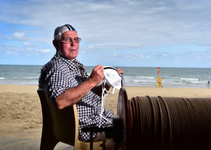 Maroochydore SLSC is capping its 177 champions including number 1 cap John Rigby. Peter Rigby in cap 4, holding his brother John's number 1 cap. Photo: Che Chapman / Sunshine Coast Daily