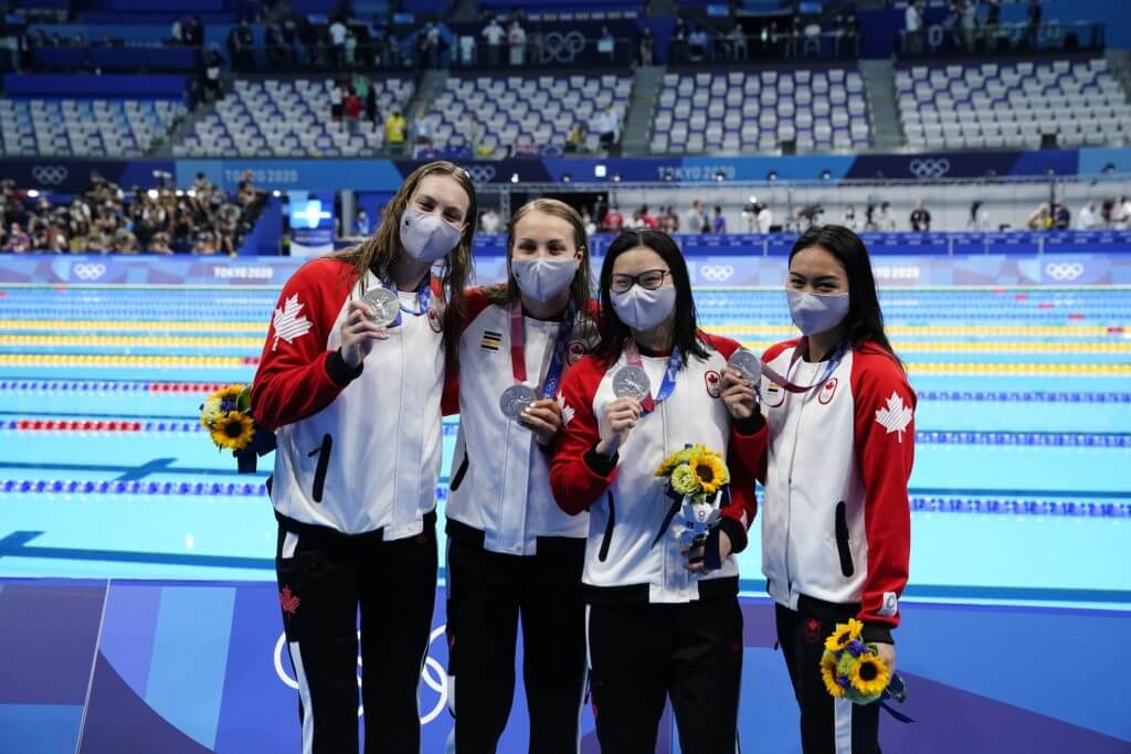 Jul 25, 2021; Tokyo, Japan; Canada team members Kayla Sanchez, Margaret Macneil, Rebecca Smith and Penny Oleksiak with their silver medals during the medals ceremony for the women's 4x100m freestyle relay during the Tokyo 2020 Olympic Summer Games at Tokyo Aquatics Centre. Mandatory Credit: Rob Schumacher-USA TODAY Network