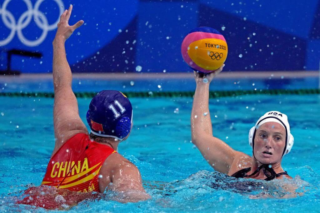 Jul 26, 2021; Tokyo, Japan; United States driver Kaleigh Gilchrist (10) handles the ball against China centre forward Xiao Chen (11) in womens group B water polo during the Tokyo 2020 Olympic Summer Games at Tatsumi Water Polo Centre. Mandatory Credit: Kirby Lee-USA TODAY Sports