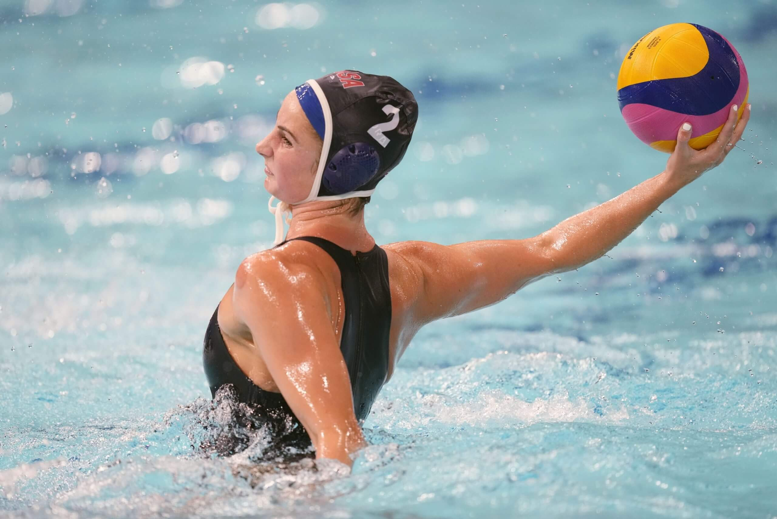 Jul 28, 2021; Tokyo, Japan; USA player Madeline Musselman (2) prepares to shoot against Hungary in a group B match during the Tokyo 2020 Olympic Summer Games at Tatsumi Water Polo Centre. Mandatory Credit: James Lang-USA TODAY Sports