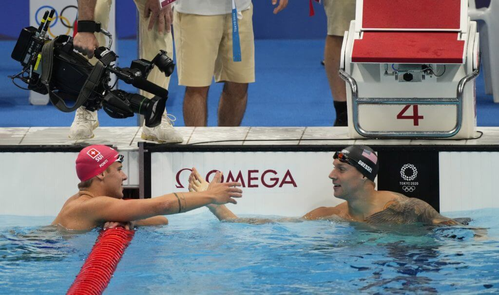 Jul 30, 2021; Tokyo, Japan; Caeleb Dressel (USA) shakes hands with Noe Ponti (SUI) after the men's 100m butterfly semifinals during the Tokyo 2020 Olympic Summer Games at Tokyo Aquatics Centre. Mandatory Credit: Rob Schumacher-USA TODAY Sports
