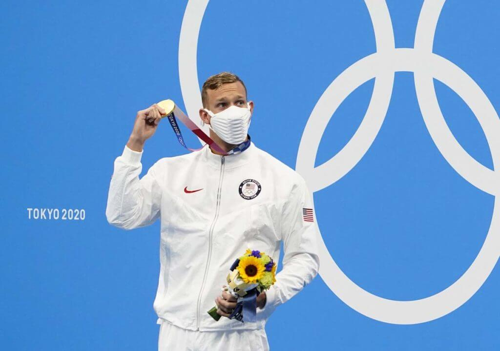 Jul 29, 2021; Tokyo, Japan; Caeleb Dressel (USA) with his gold medal during the medals ceremony for the men's 100m freestyle during the Tokyo 2020 Olympic Summer Games at Tokyo Aquatics Centre. Mandatory Credit: Rob Schumacher-USA TODAY Sports