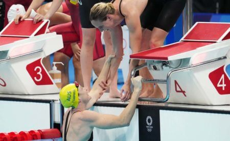 Jul 25, 2021; Tokyo, Japan; Cate Campbell (AUS) celebrates after anchoring Australia to a gold medal during the women's 4x100m freestyle relay final during the Tokyo 2020 Olympic Summer Games at Tokyo Aquatics Centre. Mandatory Credit: Robert Hanashiro-USA TODAY Network