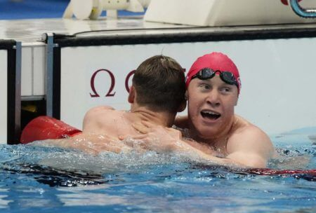 Jul 27, 2021; Tokyo, Japan; Tom Dean (GBR) celebrates with Duncan Scott (GBR) after placing first and second in the men's 200m freestyle final during the Tokyo 2020 Olympic Summer Games at Tokyo Aquatics Centre. Mandatory Credit: Rob Schumacher-USA TODAY Sports