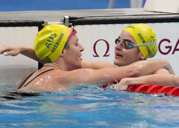 Jul 25, 2021; Tokyo, Japan; Kaylee McKeown (AUS) with Emily Seebohm (AUS) after the women's 100m backstroke heats during the Tokyo 2020 Olympic Summer Games at Tokyo Aquatics Centre. Mandatory Credit: Rob Schumacher-USA TODAY Sports