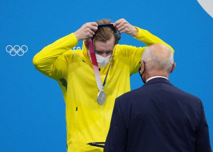 jack mcloughlin, olympics, Jul 25, 2021; Tokyo, Japan; Jack McLoughlin (AUS) puts on his silver medal during the medals ceremony for the men's 400m freestyle during the Tokyo 2020 Olympic Summer Games at Tokyo Aquatics Centre. Mandatory Credit: Robert Hanashiro-USA TODAY Network