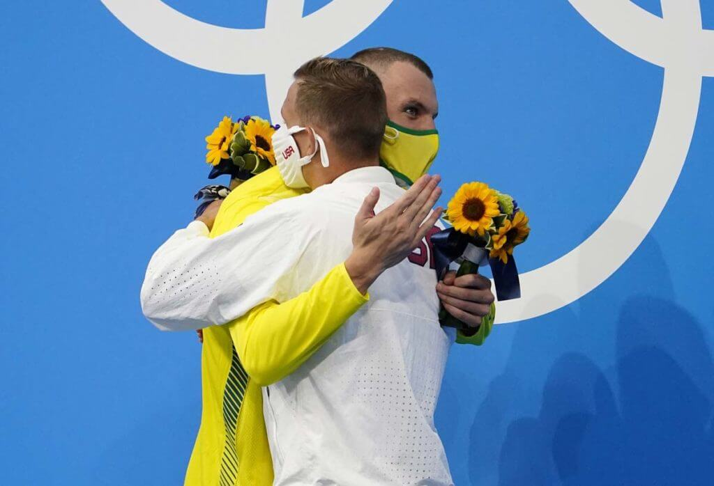 kyle chalmers, caeleb dressel, olympics,Jul 29, 2021; Tokyo, Japan; Caeleb Dressel (USA) hugs Kyle Chalmers (AUS) during the medals ceremony for the men's 100m freestyle during the Tokyo 2020 Olympic Summer Games at Tokyo Aquatics Centre. Mandatory Credit: Rob Schumacher-USA TODAY Sports