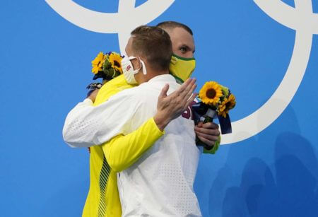 Jul 29, 2021; Tokyo, Japan; Caeleb Dressel (USA) hugs Kyle Chalmers (AUS) during the medals ceremony for the men's 100m freestyle during the Tokyo 2020 Olympic Summer Games at Tokyo Aquatics Centre. Mandatory Credit: Rob Schumacher-USA TODAY Sports