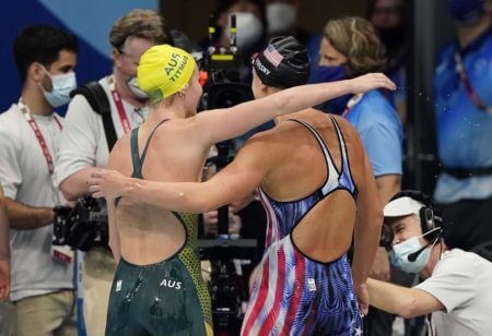 Jul 26, 2021; Tokyo, Japan; Ariarne Titmus (AUS) hugs Katie Ledecky (USA) after the women's 400m freestyle final during the Tokyo 2020 Olympic Summer Games at Tokyo Aquatics Centre. Mandatory Credit: Rob Schumacher-USA TODAY Sports