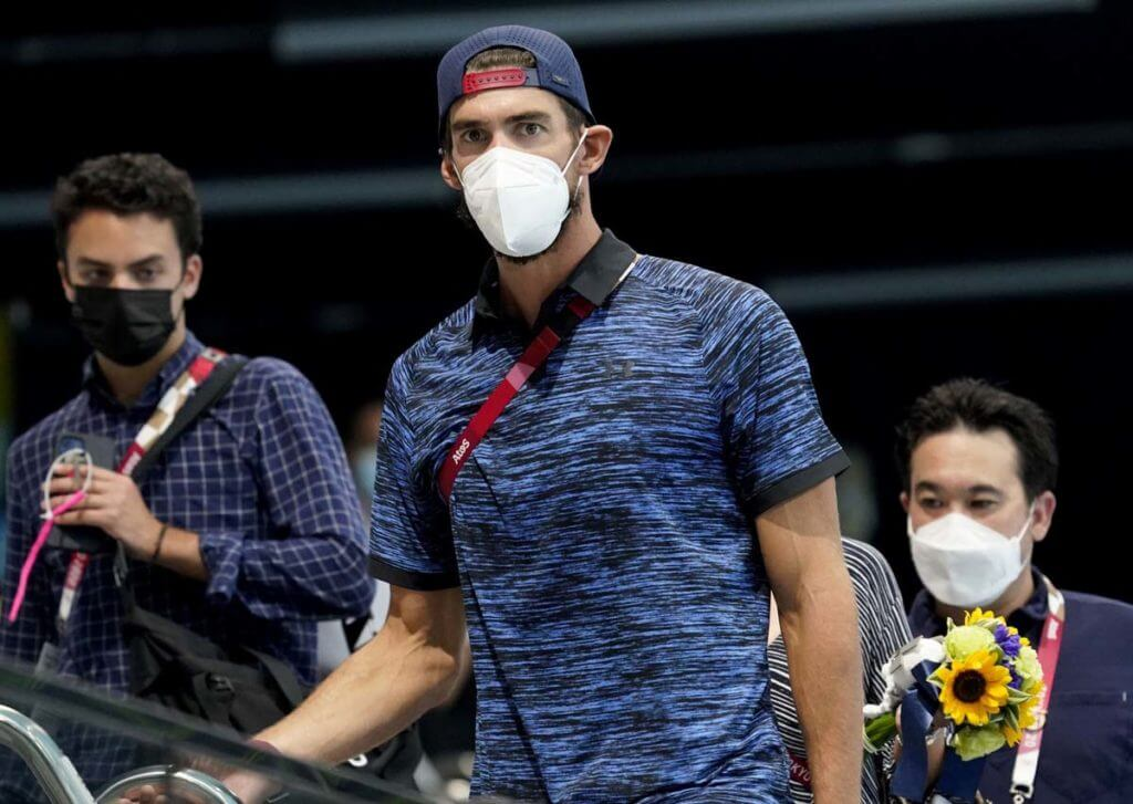 Jul 29, 2021; Tokyo, Japan; Michael Phelps looks out on the pool deck at a break in competition during the Tokyo 2020 Olympic Summer Games at Tokyo Aquatics Centre. Mandatory Credit: Grace Hollars-USA TODAY Sports