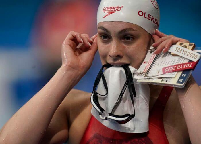 Jul 28, 2021; Tokyo, Japan; Penny Oleksiak (CAN) walks out of the pool after the women's 100m freestyle heats during the Tokyo 2020 Olympic Summer Games at Tokyo Aquatics Centre. Mandatory Credit: Grace Hollars-USA TODAY Sports