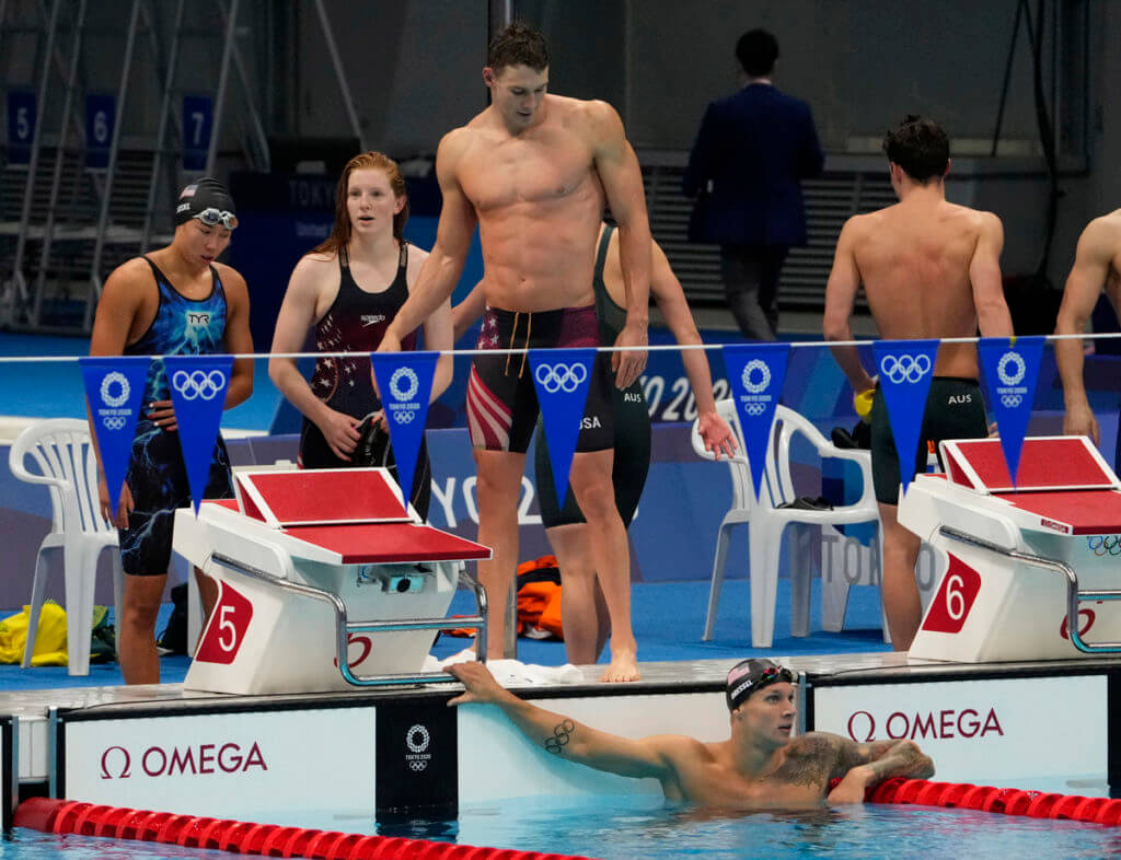 Jul 31, 2021; Tokyo, Japan; USA relay team reacts after the mixed 4x100m medley relay final during the Tokyo 2020 Olympic Summer Games at Tokyo Aquatics Centre. Mandatory Credit: Rob Schumacher-USA TODAY Sports