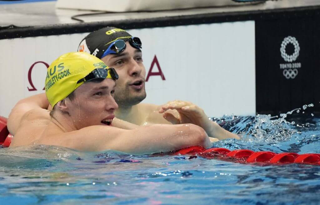 Jul 27, 2021; Tokyo, Japan; Arno Kamminga (NED) and Izaac Stubblety-Cook (AUS) after the men's 200m breaststroke heats during the Tokyo 2020 Olympic Summer Games at Tokyo Aquatics Centre. Mandatory Credit: Rob Schumacher-USA TODAY Sports