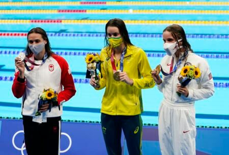 Jul 27, 2021; Tokyo, Japan; From left Kylie Masse (CAN) , Kaylee McKeown (AUS) and Regan Smith (USA) with their medals after the women's 100m backstroke final during the Tokyo 2020 Olympic Summer Games at Tokyo Aquatics Centre. Mandatory Credit: Robert Hanashiro-USA TODAY Sports