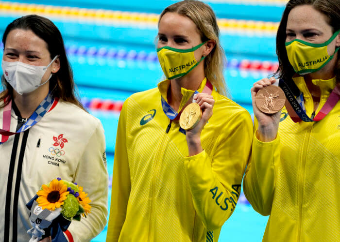 Jul 30, 2021; Tokyo, Japan; Siobhan Bernadette Haughey (HKG), from left, Emma McKeon (AUS) and Cate Campbell (AUS) pose with their medals after taking the top spots in the women's 100m freestyle final during the Tokyo 2020 Olympic Summer Games at Tokyo Aquatics Centre. Mandatory Credit: Grace Hollars-USA TODAY Sports