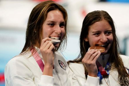 Jul 28, 2021; Tokyo, Japan; From left Alex Walsh (USA) and Kate Douglass (USA) pose with their medals during the medals ceremony for the women's 200m individual medley during the Tokyo 2020 Olympic Summer Games at Tokyo Aquatics Centre. Mandatory Credit: Rob Schumacher-USA TODAY Sports