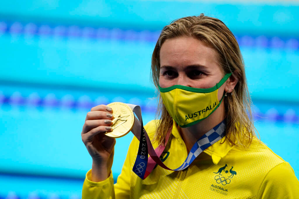 Jul 28, 2021; Tokyo, Japan; Ariarne Titmus (AUS) with her gold medal during the medals ceremony for the women's 200m freestyle during the Tokyo 2020 Olympic Summer Games at Tokyo Aquatics Centre. Mandatory Credit: Rob Schumacher-USA TODAY Sports