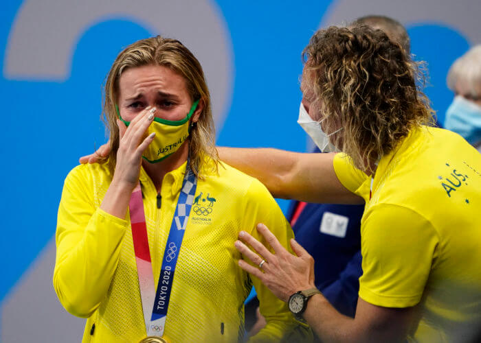 Jul 28, 2021; Tokyo, Japan; Ariarne Titmus (AUS) reacts after receiving her gold medal during the medals ceremony for the women's 200m freestyle during the Tokyo 2020 Olympic Summer Games at Tokyo Aquatics Centre. Mandatory Credit: Rob Schumacher-USA TODAY Sports